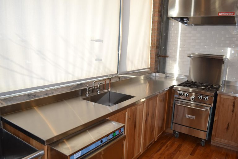 stainless steel countertop facing a big window