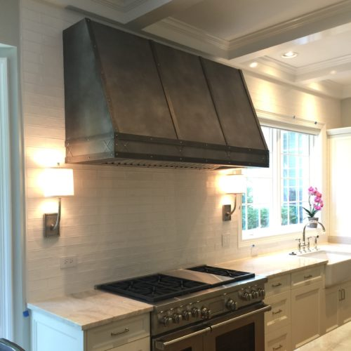 installed zinc rangehood on dimmed lit kitchen