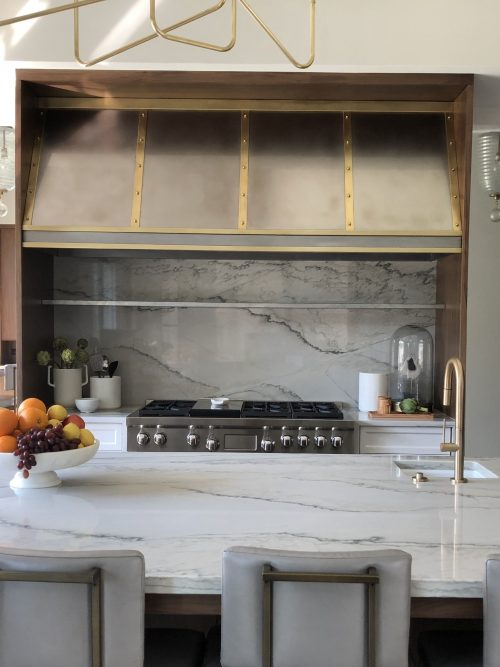 portrait of installed zinc and brass rangehood